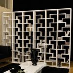 Cool and modern white bookshelves design separating two spaces