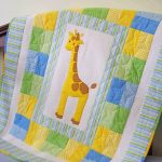 Cozy Baby Boy Quilt With Girrafe Image In The Center