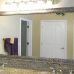 Crafted nickel frame for large bathroom vanity mirror