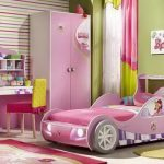 Cute-Wonderful-Pink-Race-Car-Bed-Design-for-Little-girl-with-barbie-picture-and-pink-wardrobe-and-green-wall-and-pink-and-yellow-chair