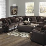 Dark Brown Of U Shaped Sofa With Pillows Table Small Rug On Hardwood Floor