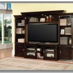 Dark brown coated wooden entertainment center IKEA with storage a flat TV set