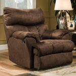 Deep upholstered brown recliner in large size and hidden footboard feature