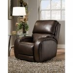 Elegant and classy dark brown leather reclining sofa a round glass top side table with black stained metal legs a table lamp with white cap
