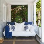 Extra comfortable outdoor daybed with white mattress and blue and white pillows
