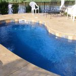 Fiberglass Pool With Custom Shape ANd White Pool Furniture
