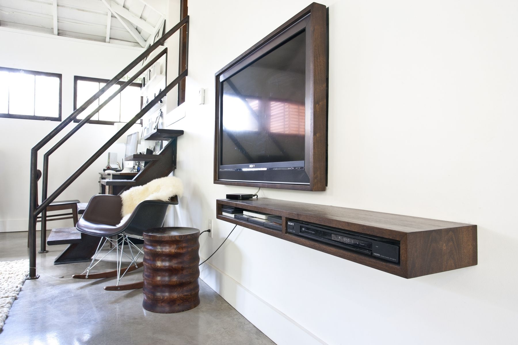 Floating Wooden Shelf On White Wall Near Flat Tv In Living Room With Chair And Tile