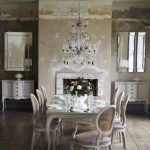 French style dining room decorating idea with French inspired furniture luxurious and crystal pendant chandelier fixture a pair of brushed nickel mirrors a pair of dishware cabinets