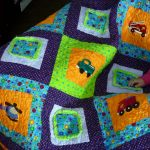 Fun colored quilt for baby boy with car types images