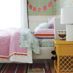 Girl Bedroom With Colorful Bedding White And Red On Bed Pillows Wallpaper Rug Cabinet