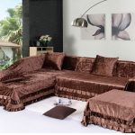 Glossy brown slipcover idea for sectional with double chaise and throw pillows