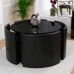 Glossy round table with four modern black leather chairs