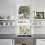 Grey quartz countertop for kitchen with deep sink and faucet a gas stove  white floating dishware shelving units