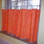 Half way window curtain in bright orange