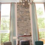 Higher curtain rail mounted on ceiling blue floor to top window curtain a classic pendant lamp