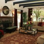Interior Amazing Classic Spanish Style Of Living Room Design With Stone Fireplace Red Curtain LArge Carpet And Sofa
