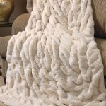 Ivory Mink Couturefaux fur blanket queen decorated on comfy chair together with beige furry rug for comfortable home ideas