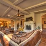 Large Vaulted Living Room With Showing Beams Cool Sofa Stone Fireplace Lamp With Fan Near Kitchen