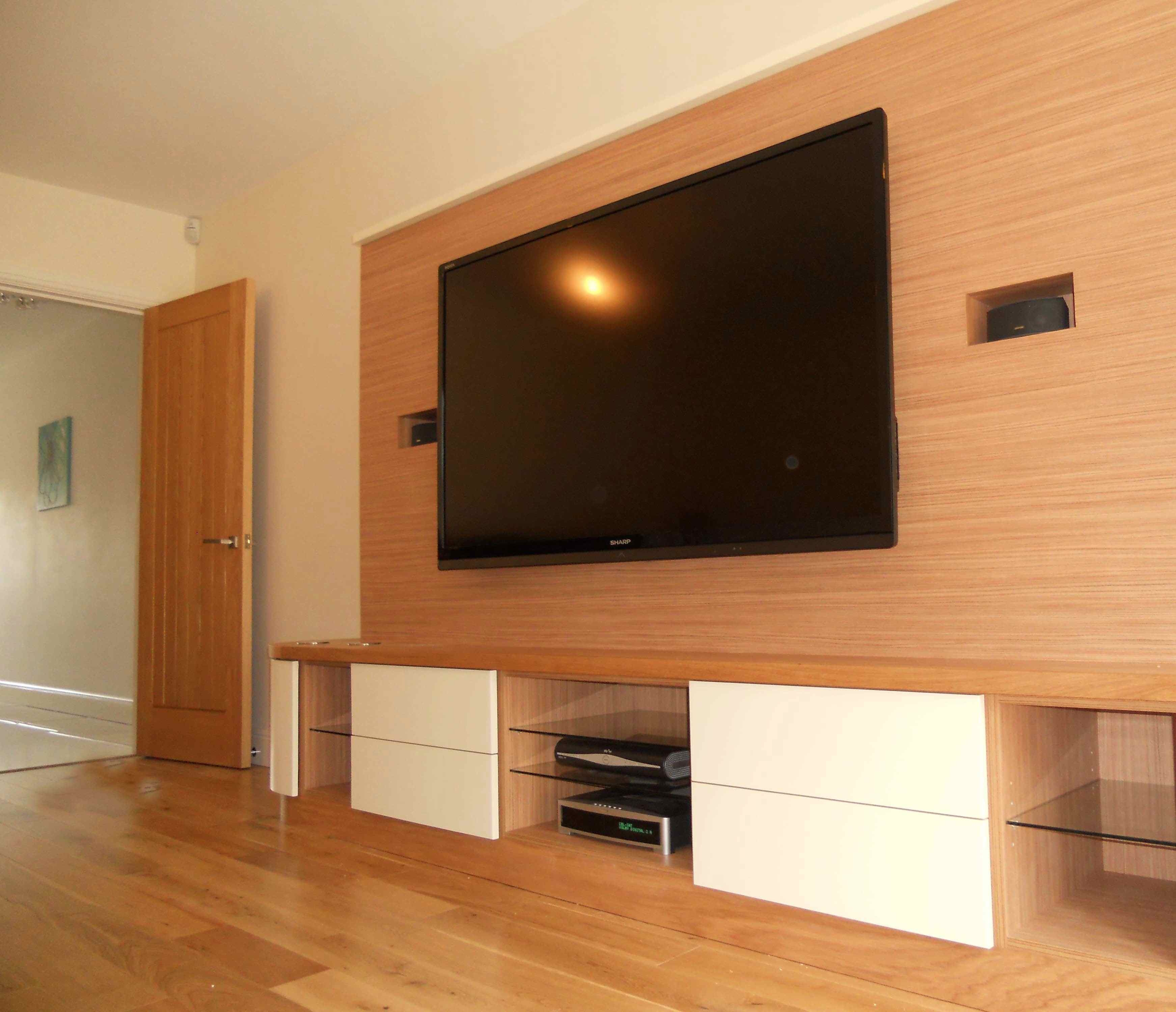 Large Wood Wall Covering Idea For Flat Tv And Cabinet