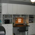 Large wall cabinetry with shelves and folding desk a working chair