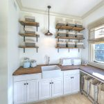 Laundry shelves idea with a lot of rattan boxes as the storages L shaped countertop with wooden surface and white deep sink plus faucet a series of under cabinets a pendant lamp