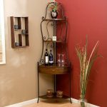 Luxurious and beautiful classic wrought iron corner shelving idea with single wood drawer