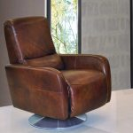 Luxurious and expensive brown leather swivel recliner design with armrest