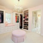 Luxurious crystal lighting in a changing room which is full of closet storage units