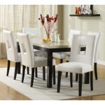 Marble Kitchen Table And Six White Chairs And White Carpet And White Curtain