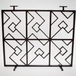Metal fireplace screen with modern pattern