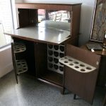 Mix vintage modern bar cabinet design with the bottle holders and metal countertop