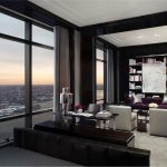 Modern Apartment With Black Color Living Room Libabry On Wall Purple Sofa With Two White Chairs And Long Curtains On Big Windows