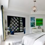 Modern bedroom decorating idea showing pure white wall paint white bedding grey bedcover built in bookcases in cool design and black curtain x base corner table in white a pendant lamp