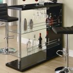 Modern-contemporary-style-of-black-Fairlie-Pub-Table-by-Wildon-Home-with-beverages-and-glasses-near-the-wall-and-wooden-floor