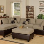Modern microfiber reclining sectional idea in grey a pair of decorative pillows a coffee table ottoman with leather cover at bottom of ottoman small size jute rug for living room