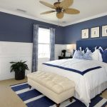 Navy blue wall paint for bedroom a king sized bed furniture with navy blue headboard a white daybed without back feature blue and white rug for bedroom a ceiling fan black wooden bedside table