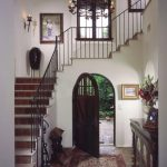 Neautral Spanish Design On Entrance And Stairs With Cool Rug Chandelier And Wooden Cabinet