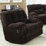 Oversized black upholestered recliner with hidden footboard