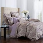 Oversized duvet cover idea with classic pattern round black wood bedside table with undershelf