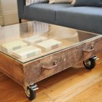 Oversized frameless transparent glass coffee table with storage and wheels