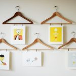 Photo hanging clips that are designed like clothes hangers