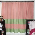 Pink And Green Blackout Curtain Near Bed And Stylish Bedding With Wooden Cabinet