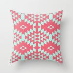 Pink accent pillow with blue decoration