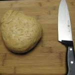 Potato An Knife On Wood Cutting Board