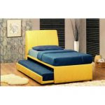 Pretty yellow pull out bed with navy blue bedding idea
