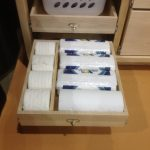 Pull out drawer for and large plastic storage box in bathroom cabinet unit