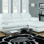 Pure white small sectional idea with chaise for modern living room cool and modern glossy black top coffee table black and white wool rug for living room a console table in black a modern floor lamp