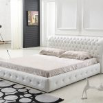 Queen bed furniture with curly white leather headboard white bedding and white pillows modern bedroom rug with big polka dots