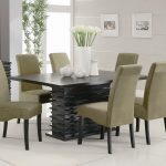 Rectangle Black Wooden Table Combined With Cream Leather Chairs With Black Wooden Legs White Floor Dining Room