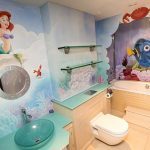 Sea-themed-bathroom-for-kids-with-ariel-and-nemo-painted-on-the-wall-also-tosca-sink-and-wooden-floor